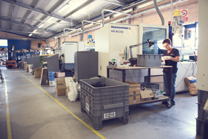 Thermoplastic moulding department where specialised operators work.